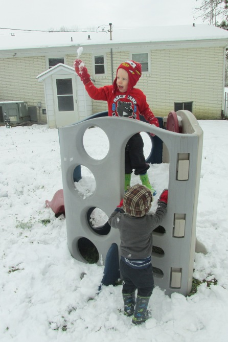 He turned the slide into his snow fort!