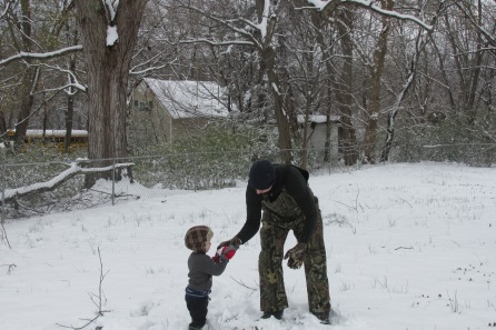 Dad is trying to teach Joshua how to throw a snowball. So sweet!